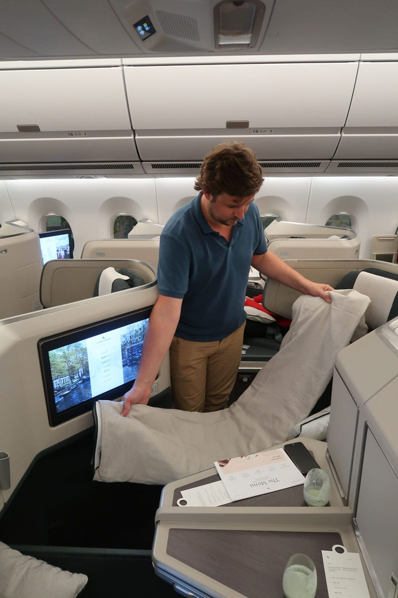 cathay pacific business class slapen aan boord
